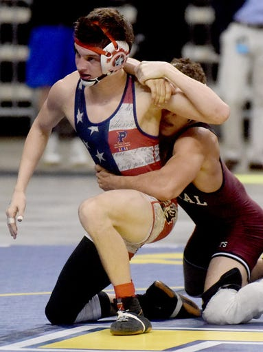 Parkway's Trevor Tamburo tries to fend off his opponent