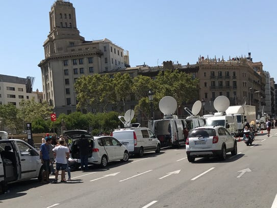 News media from all over the world line La Rambla Street