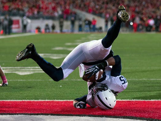 Penn State receiver Brandon Felder tumbles into the end zone for a 12-yard touchdown during the second quarter against Ohio State in Columbus. Felder's score was one of very few bright spots for Penn State in a 63-14 loss.