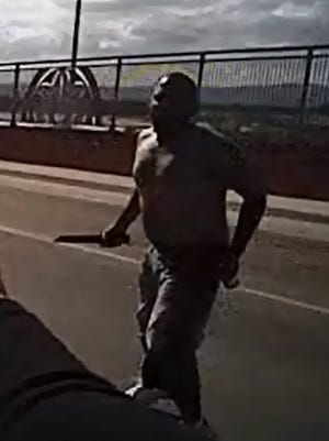 The Las Cruces Police Department released this image of Juan Gabriel Torres, 36, who was shot and killed by police on Sunday, Aug. 21, 2016, on the Lohman Avenue bridge over Interstate 25. Police said Torres, holding a knife in one hand a beer can in the other, lunged at police before being shot.