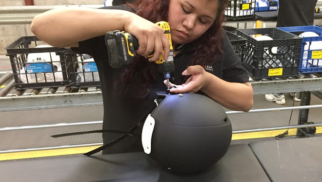Gisselle Sandoval assembles a football helmet at Xenith's new manufacturing site in southwest Detroit.