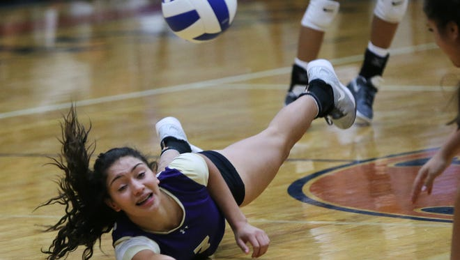 Burges' Savannah Marenco makes a diving save of a Riverside hit during the first game of their bi-district match Monday at Riverside.