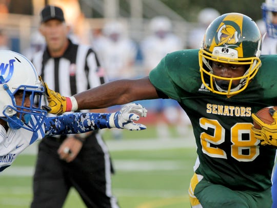 Taft's  Oramani Zanders  runs the ball for the Senators during the football game against Wyoming, Friday, Sept.2, 2016.