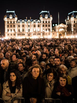 People gather outside of Notre Dame Cathedral ahead of a ceremony to the victims of the Friday's terrorist attacks on November 15, 2015 in Paris, France.
