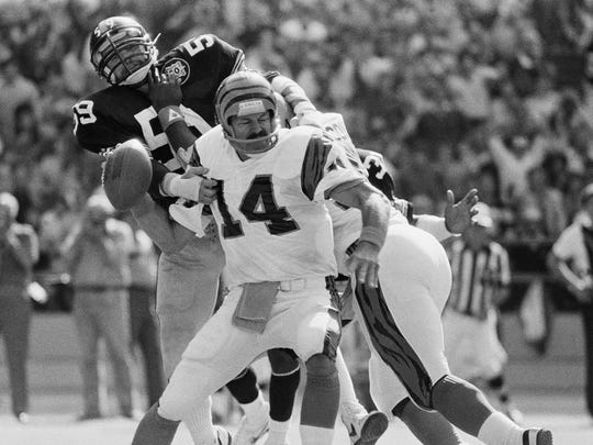 Steelers linebacker Jack Ham grabs Bengals quarterback Kenny Anderson's arm, forcing an interception on Sept. 19, 1982 in Pittsburgh.