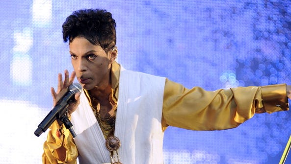 Prince performs on stage at the Stade de France in Saint-Denis, outside Paris, on June 30, 2011.
