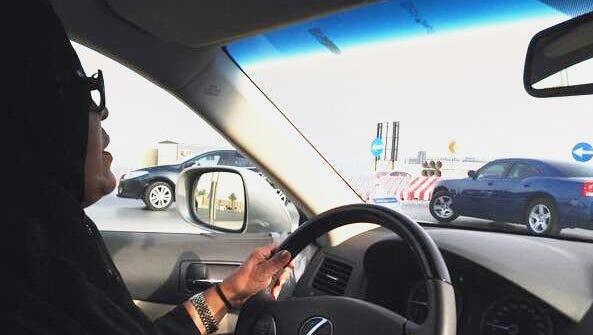 A Saudi woman, identified as  Ameerah al Muneef, drives through Riyadh on Oct. 10 in violation of a ban on women drivers.