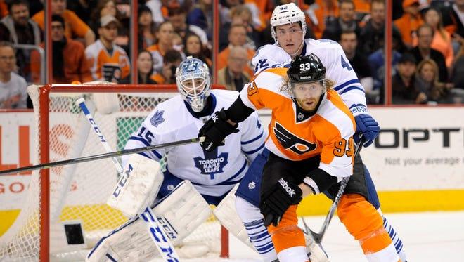 Philadelphia Flyers right wing Jakub Voracek (93) and Toronto Maple Leafs center Tyler Bozak (42) battle in front of goalie Jonathan Bernier (45) during the first period at Wells Fargo Center.