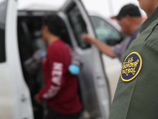 U.S. border agents detain an undocumented immigrant