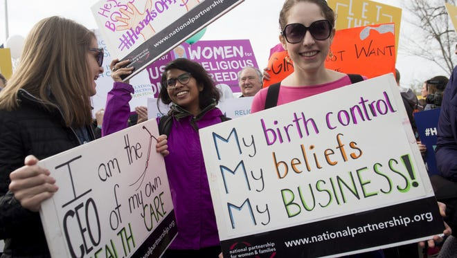Supporters of women's health rally outside the Supreme Court in Washington, DC, March 23, 2016