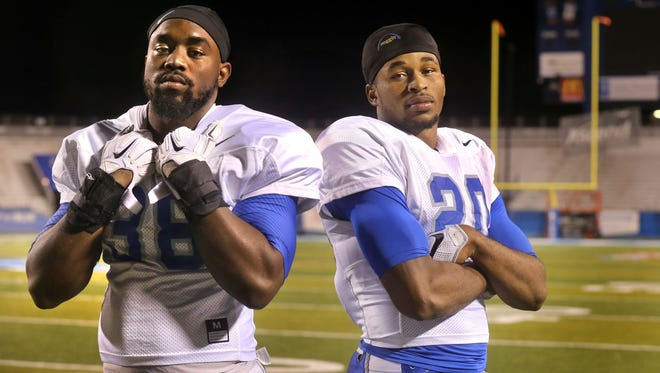 MTSU seniors T.T. Barber (38) and Kevin Byard on the MTSU field on Tuesday Nov. 17, 2015. The two will be playing their final home game in their college career on Saturday against North Texas.