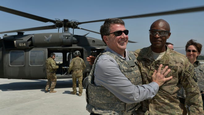 Deputy Secretary of Defense Ashton B. Carter, left, is welcomed by Brig. Gen. Ron Lewis at Jalalabad Air Base in the Nangarhar province of Afghanistan on May 13, 2013.