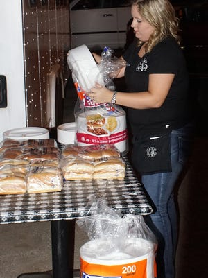 April Glenn with the Townville Cafe makes final preparations for the Townville Block Party.