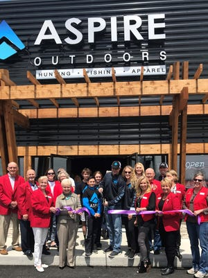 Chamber Ambassadors cut the Ribbon for Aspire Outdoors on April 21during their Grand Opening.Aspire Outdoors celebrated their Grand Opening with food, special guests andgiveaways.Aspire Outdoors is located at 2492 U.S. Highway 62 E. inMountain Home. Business hours are Monday-Saturday from 8a.m.-8p.m. and Sundays 1p.m.-7p.m.