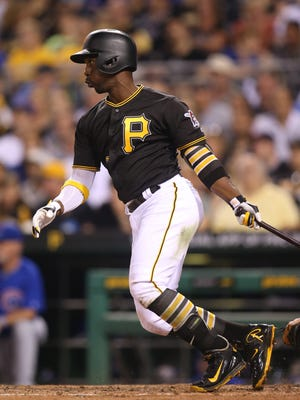 Pirates center fielder Andrew McCutchen hits an RBI single against the Cubs during the seventh inning at PNC Park.