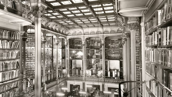 The cast-iton bookcases and massive skylight of the main hall of the Old Main Library still attract attention decades after the library was torn down in 1955.