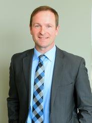 John Doran, senior director of public relations for