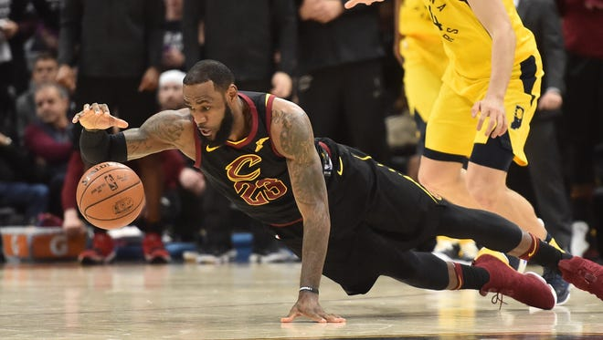 LeBron James dives for the ball in front of Pacers forward Bojan Bogdanovic during the second half of Game 7.