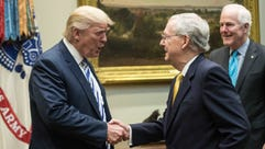 President Trump shakes hands with Senate Majority Leader