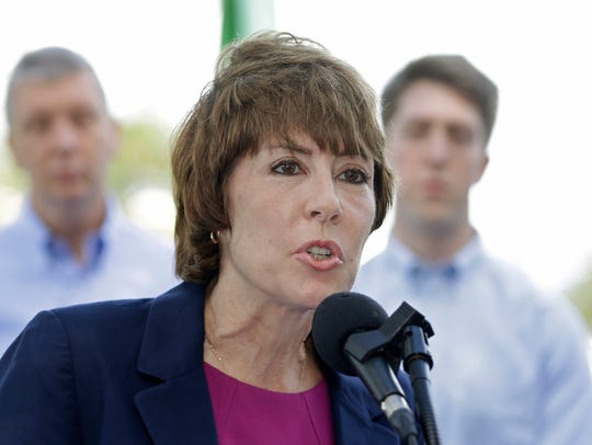 Former Democratic U.S. Rep. Gwen Graham speaks to reporters