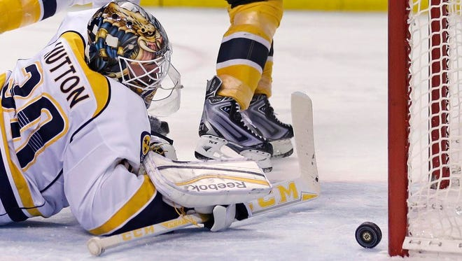 Predators goalie Carter Hutton looks back at the puck after giving up a goal to Bruins left wing Loui Eriksson during the second period,