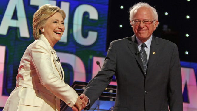 Hillary Clinton and Bernie Sanders shake hands during the Democratic presidential candidate debate at Brooklyn Navy Yard.
