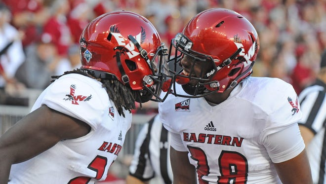 Eastern Washington  running back Antoine Custer Jr. (28) and wide receiver Nsimba Webster (22) celebrate a touchdown against Washington State.