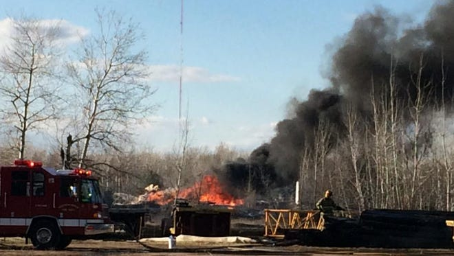 Black smoke billows from the scene of a fire at near Wilson Street and Bonow Avenue in Wisconsin Rapids.