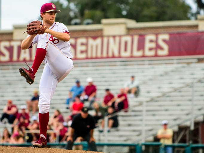 Andrew Karp (19), pitches during the 4-2 USF victory