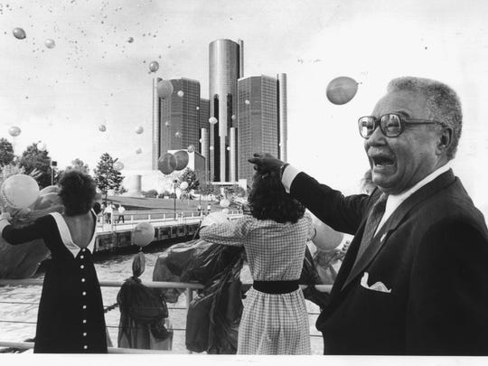 "Detroit Mayor Coleman Young laughs as 1,000 balloons are released from the Landsdowne restaurant at his birthday party on May 24, 1984. Each balloon had written on it ""Happy Birthday Coleman."" Photo by Craig Porter"