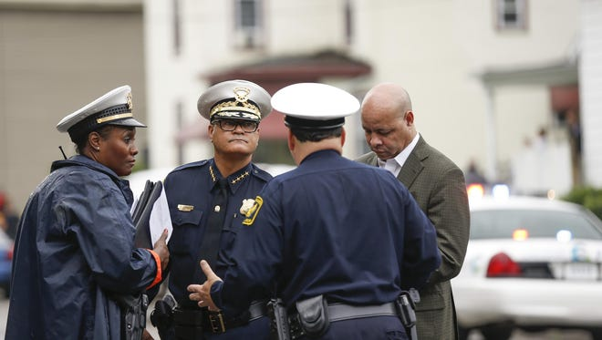 Cincinnati Chief of Police Jeffrey Blackwell speaks with officers at the scene of the shooting in Madisonville Friday morning.