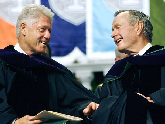Former Presidents Bill Clinton, left, and George H.
