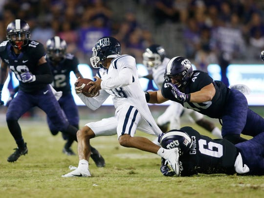 Sep 2, 2017; Fort Worth, TX, USA; Jackson State Tigers quarterback Jordan Williams (18) is sacked by TCU Horned Frogs defensive end Michael Epley (40) and safety Innis Gaines (6) in the third quarter at Amon G. Carter Stadium. Mandatory Credit: Tim Heitman-USA TODAY Sports
