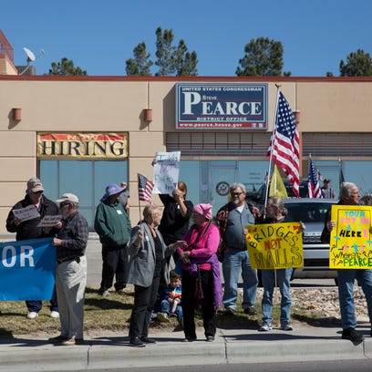 Over 200 protesters gathered in front of Rep. Steve