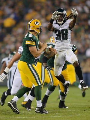 Philadelphia Eagles cornerback E.J. Biggers (38) puts a late hit on Green Bay Packers quarterback Matt Blanchard (6) in the fourth quarter during Saturday night's preseason game at Lambeau Field.