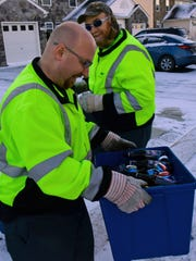 Jeff Walls, front, and Paul Poe, of Waste Management, collect items to be recycled along Kelhigh Drive, Chambersburg.