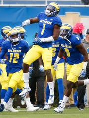 Delaware defensive back Malcolm Brown celebrates an interception on a fourth down pass deep in Hens territory in the first quarter at Delaware Stadium Saturday.