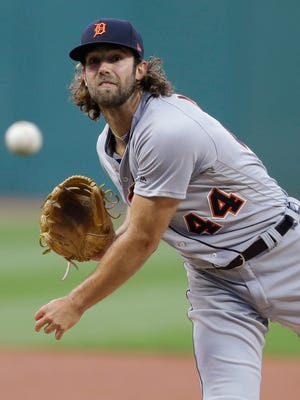 Detroit Tigers starting pitcher Daniel Norris delivers during the first inning against the Cleveland Indians, Friday, April 14, 2017 in Cleveland.