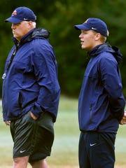 Blackman head coach David Watson, left, with his son