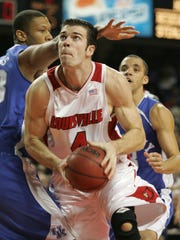 UofL's David Padgett, #4, worked against Randolph Morris, #33, during the UK/UL game at Freedom Hall.  LOCAL STAFF/DEC. 16, 2006/SAM UPSHAW JR. PHOTO