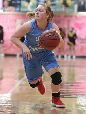 Gibson County's Macey Neal dribbles toward the basket during a game against Peabody on Monday.