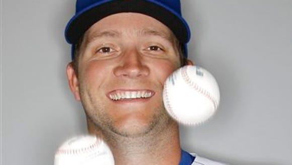 Chicago Cubs' Adam Warren juggles some baseballs during