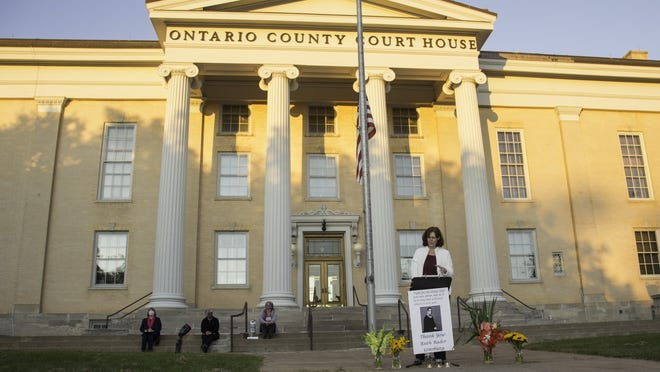 Ontario County Bar Association President Teresa Paré speaks of the legacy of the late Supreme Court Justice Ruth Bader Ginsburg on Sunday at the Ontario County Courthouse.