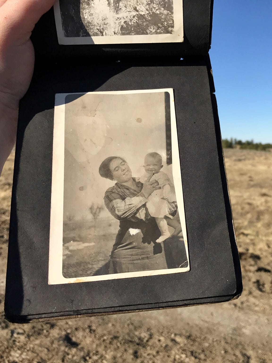 Orra Jones cuddles one of her children in a photo taken more than 90 years ago on a homestead in the Upper Missouri Breaks.