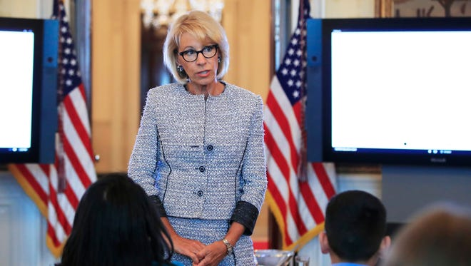 Education Secretary Betsy DeVos speaks during a discussion with first lady Melania Trump and students regarding the issues they are facing in the Blue Room of the White House in Washington, Monday, April 9, 2018.