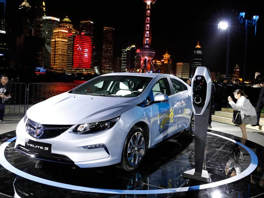 Visitors take photos of the Buick Velite 5, an extended