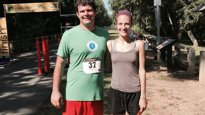 The author, Andy Sandrik, left, poses with Abby Huber, the top female finisher at last weekend's SFC Randall Shughart 5 Miler. Not only did Huber, a former Ship U. runner, break the women's record, she also helped pace Sandrik to a race PR.