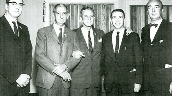 Carl Nelson, second from right, is seen among other