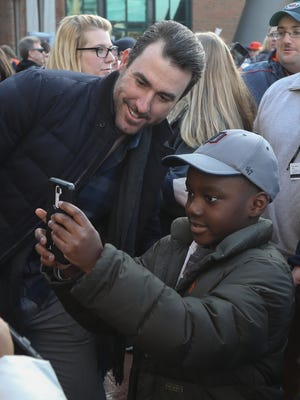 Tigers pitcher Justin Verlander takes a picture with Korry Buxton at TigerFest Saturday, at Comerica Park.