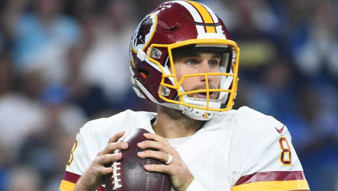 Washington Redskins quarterback Kirk Cousins (8) drops back to pass during the first quarter against the Detroit Lions at Ford Field.
